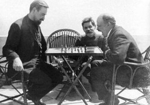 Bogdanov plays chess with Lenin while Maksim Gorky looks on (1908)